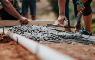 Closeup of cement work being done as aprt of volunteer opportunities for nonprofits.