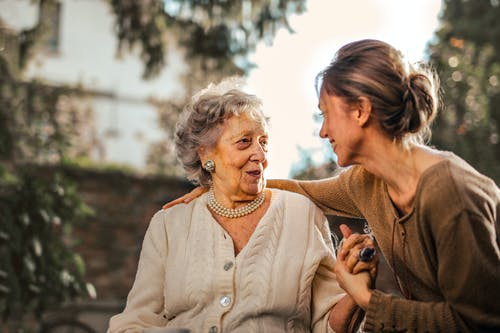woman visiting elderly lady